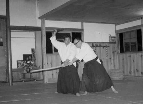 1969. Saito Sensei with stick vanquishes Bill Witt with ken.
